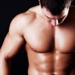 Athlete showing his abdominal muscles — Stock Photo