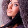Attractive young brunette in her coat — Stock Photo #1462663