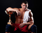 Picture of sportsman holding cup — Stock Photo