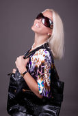 Portrait of young sexy woman with bag — Stock Photo
