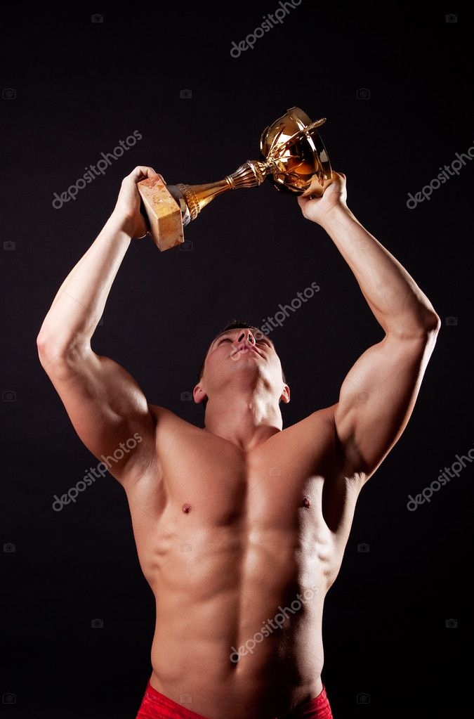 Handsome strong champion and his trophy — Stock Photo #1461970