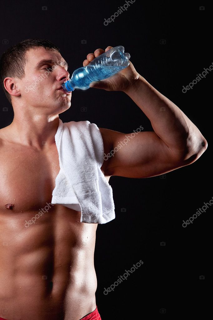 Portrait of muscular sportsman drinking water — Stock Photo #1461989