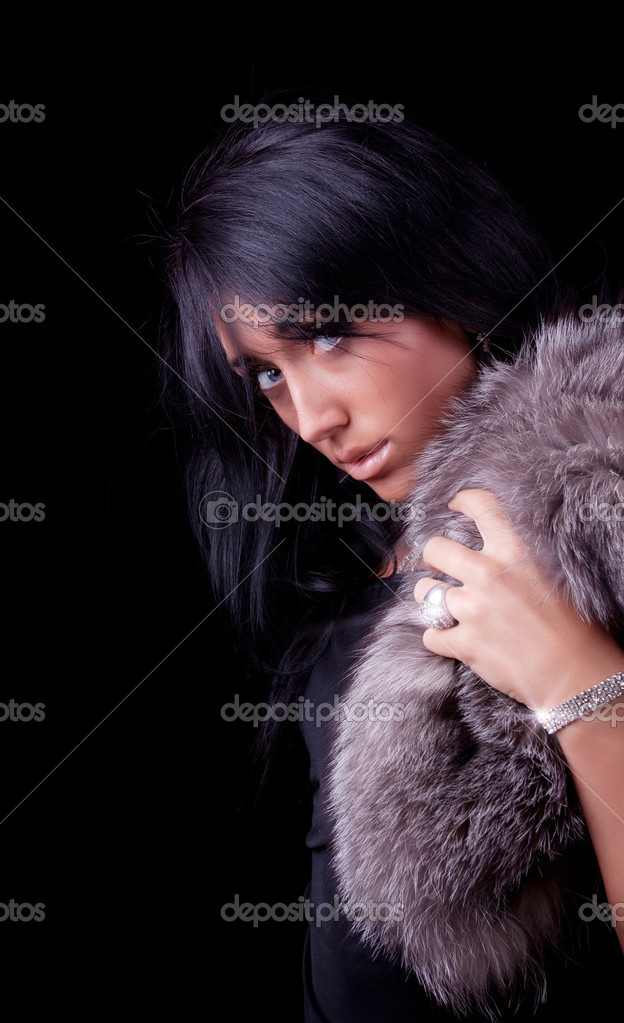Portrait of a attractive sexy girl with coat and bracelet — Stock Photo #1462711