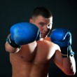 Athletic boxer during fighting — Stock Photo #1538482