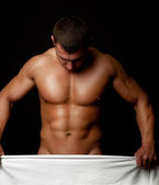 Athlete holding white towel — Stock Photo