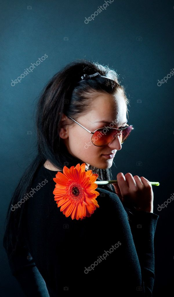 Picture of cute woman holding a red flower — Stock Photo #1538184