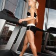 Stock Photo: Young girl exercise on treadmill