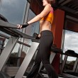 Young woman exercise on treadmill — Stock Photo #1586277