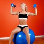 Athlete sitting on fitness ball — Stock Photo