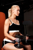 Beautiful sexy athlete with dumbbells — Stock Photo