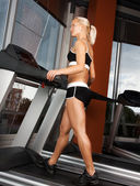 Young girl exercise on treadmill — Stock Photo