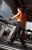 Young woman exercise on treadmill — Stock Photo