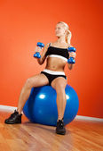 Happy athlete on fitness ball — Stock Photo