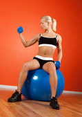 Attractive blonde sitting on ball — Stock Photo