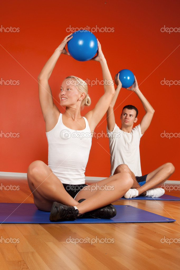 Group of happy doing exercise with fitness balls in fitness room — Stock Photo #1586625
