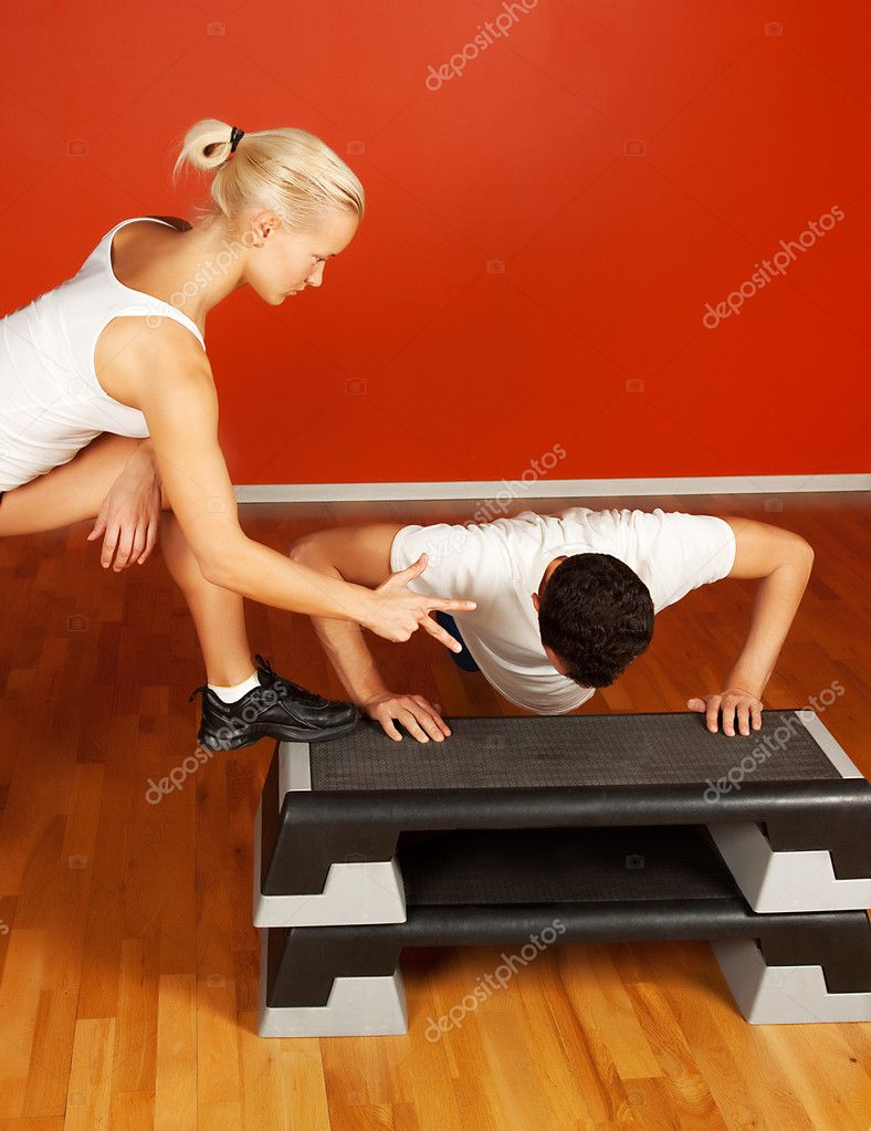 Group of doing push-up exercise. Trainer and trainee — Stock Photo #1586885