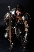 Great knight holding his sword — Stock Photo