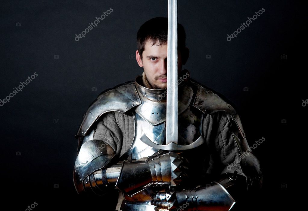Glistening Knight holding two-handed sword — Stock Photo #1999100