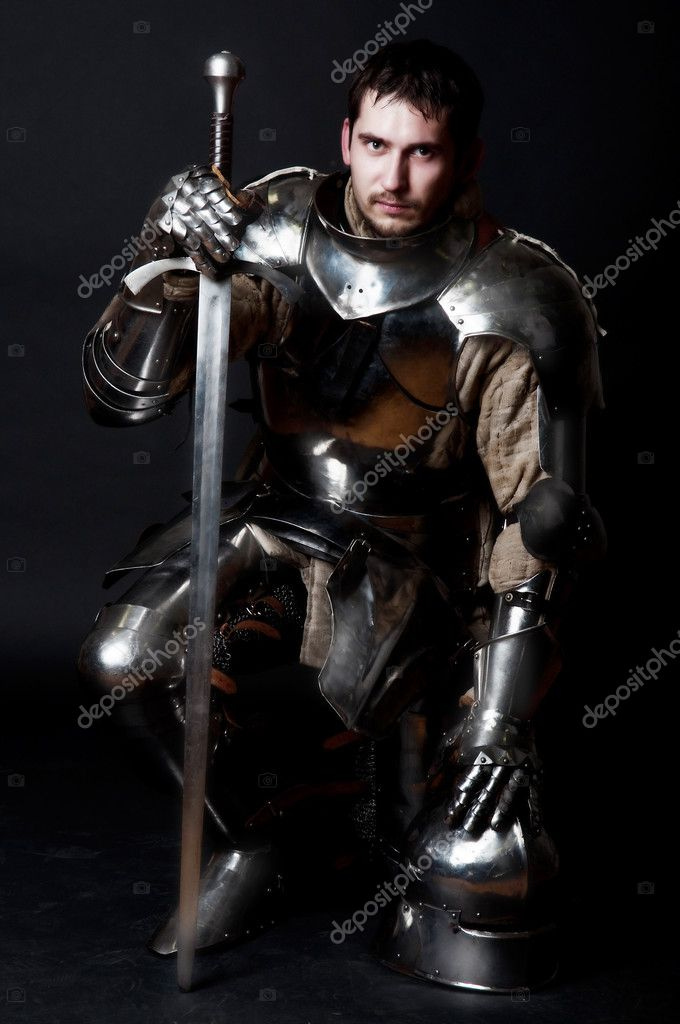 Glistening Knight with two-handed sword and helmet — Stock Photo #1999658