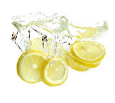 Lemon is dropped into water — Stock Photo