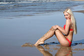 Beautiful young woman on seashore — Stockfoto