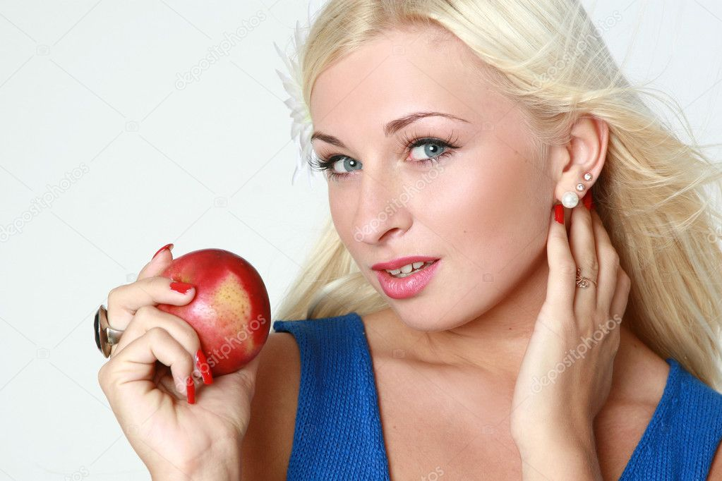 Beautiful young sexy blonde with red apple — Stock Photo #1498797