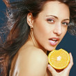 Beautiful girl with fresh juicy orange — Stock Photo