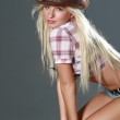 Beautiful rodeo cowgirl in cowboy hat — Stock Photo