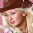 Stock Photo: Beautiful rodeo cowgirl in cowboy hat