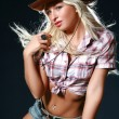 Stock Photo: Pretty blond cowgirl