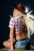 Rodeo cowgirl with cowboy hat — Stock Photo
