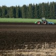 Stock Photo: Tractor works in fields