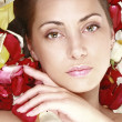 Beautiful girl with red roses petals - Lizenzfreies Foto