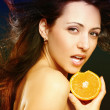 Stock Photo: Beautiful girl with fresh orange