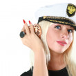 Beautiful woman in a captain — Stock Photo