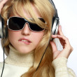 Stock Photo: Beautiful fashion woman listening music
