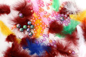 Beads and feathers — Stock Photo
