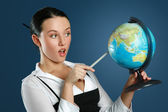 Gorgeous teacher with globe — Stock Photo