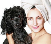 Beautiful woman with small poodle — Stock Photo
