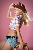 Rodeo girl wearing a cowboy hat — Stock Photo