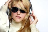 Beautiful fashion woman listening music — Stock Photo