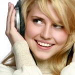 Woman listening music in headphones — Stock Photo