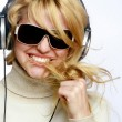 Beautiful fashion woman listening music — Stock Photo