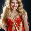 Stock Photo: Beautiful girl with beads in teeth