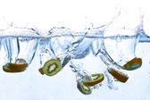 Kiwi splashing in water — Stock Photo