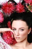 Portret piękna dziewczyna z kwiatami — Zdjęcie stockowe