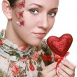 Stock Photo: Young beauty girl holding red heart