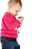 Baby girl with mobile phone — Stock Photo