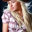 Blonde rodeo girl wearing a cowboy hat — Stock Photo