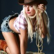 Beautiful young woman in cowboy hat — Stock Photo